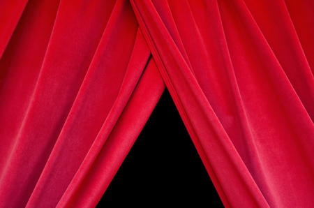 Red real velvet theater curtain closes the black stage closeup