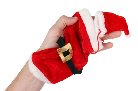 The grandfather holds in his hand a red velvet sock and a cap of Santa Stockfoto