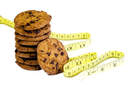 Lot of cookies with a tape measure Stock Photo - 5008464