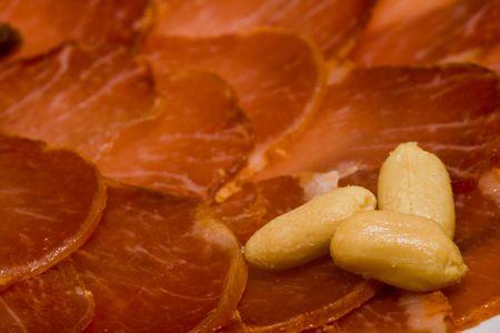 Iberian pork loin with peanuts , ready to taste photo