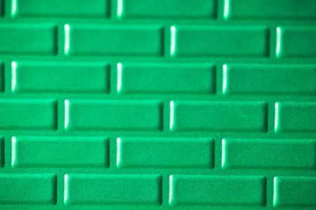A wall formed by metal bricks photo