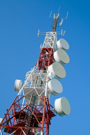 tv antenna: Communications tower with a beautiful blue sky