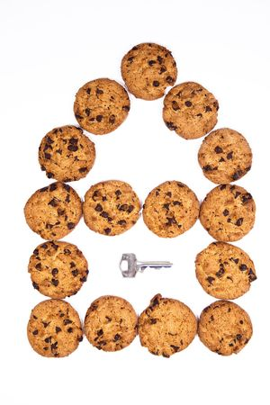 House make of chocolate cookies with a metal key Stock Photo - 5689334