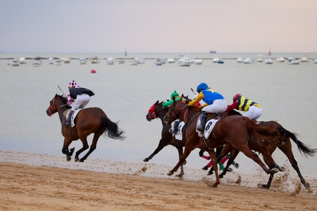 SANLUCAR DE BARRAMEDA, CADIZ, SPAIN - AUGUST 07: Horses races on August 07, 2010 on the beach of Sanlucar de Barrameda, Cadiz, Spain. The races of Sanlucar de Barrameda  are one of the most important horses races of the world Stock Photo - 9048215