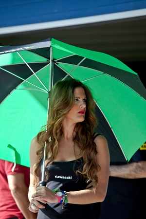 cev: JEREZ DE LA FRONTERA, SPAIN - APR 17:  Unknown pitbabe of Kawasaki Ninja Cup of the CEV Championship, posing in the pitlane before begin the race on April 17, 2011, in Jerez de la Frontera , Spain Editorial