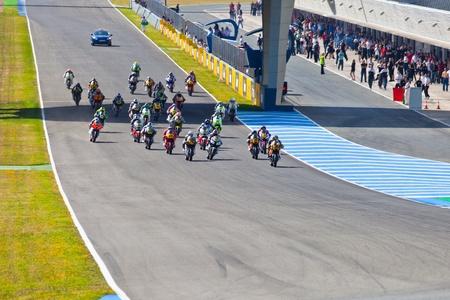 moto2: JEREZ DE LA FRONTERA, SPAIN - APR 17: Motorbike competitors begin the Moto2 race in the CEV Championship on April 17, 2011 in Jerez de la Frontera, Spain.