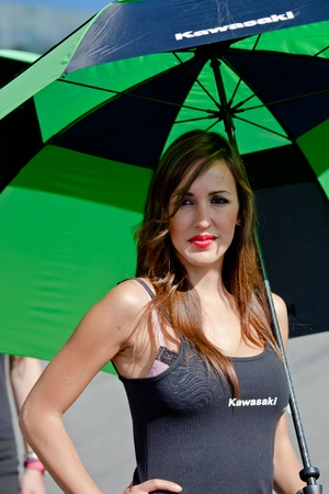 JEREZ DE LA FRONTERA, SPAIN - APR 17:  Unknown pitbabe of Kawasaki Ninja Cup of the CEV Championship, posing in the pitlane before begin the race on April 17, 2011, in Jerez de la Frontera , Spain Stock Photo - 9475761