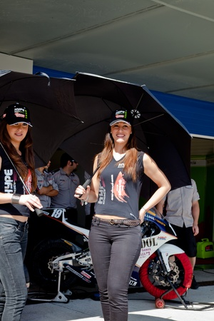 JEREZ DE LA FRONTERA, SPAIN - APR 17:  Unknown pitbabes of team Hype of 125cc of the CEV Championship, posing in the pitlane before begin the race on April 17, 2011, in Jerez de la Frontera , Spain