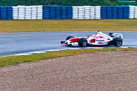 jarno: JEREZ DE LA FRONTERA, SPAIN - DEC 04: Jarno Trulli of Toyota F1 takes a curve during a training session on December 04, 2004, in Jerez de la Frontera, Spain Editorial