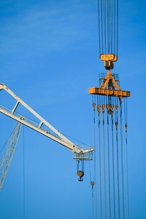 Cranes of the dockyards of C�diz in a sunny day photo
