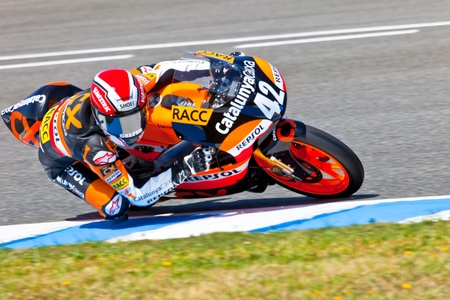 JEREZ DE LA FRONTERA, SPAIN - APR 17: 125cc motorcyclist Alex Rins takes a curve in the CEV Championship race on April 17, 2011 in Jerez de la Frontera, Spain. Stock Photo - 10067836