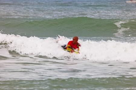 bodyboard: SAN FERNANDO, CADIZ, SPAIN - FEB 19: Unknown bodyboader taking waves on the 2nd championship of Surf and BodyBoard Impoxibol on Feb 19,2011 on the beach of Camposoto of San Fernando, Cadiz, Spain