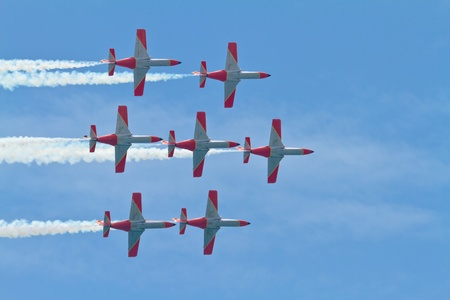 supersonic: MALAGA, SPAIN-MAY 28: Aircrafts of the Patrulla Aguila taking part in an exhibition on the day of the spanish army forces on May 28, 2011, in Malaga, Spain