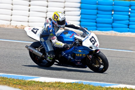 thrilling: JEREZ DE LA FRONTERA, SPAIN - APR 17: Stock Extreme motorcyclist Ferran Casas takes a curve in the CEV Championship race on April 17, 2011 in Jerez de la Frontera, Spain Editorial