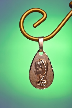 virgin girl: Precious gold pendant of the virgin girl, ideal to give  as a present for the young persons in the first communion Stock Photo