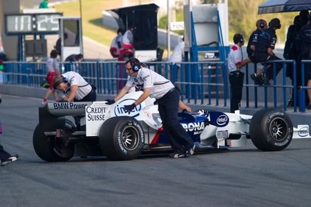 pits: JEREZ DE LA FRONTERA, SPAIN - OCT 11: Robert Kubica of BMW-Sauber F1 enters the pits during a training session on October 11, 2006 in Jerez de la Frontera , Spain Editorial