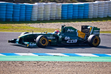 JEREZ DE LA FRONTERA, SPAIN - FEB 11: Jarno Trulli of Team Lotus F1 races on training session on February 11 , 2011, in Jerez de la Frontera , Spain Stock Photo - 10623352