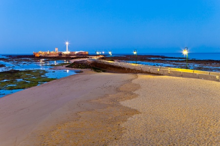 Landscape of the beach of La Caleta on  the province of Cadiz on Spain, about to dawn photo