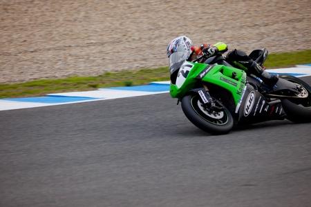 JEREZ DE LA FRONTERA, SPAIN - NOV 20: Stock Extreme motorcyclist Oscar Ibañez takes a curve in the CEV championship on Nov 20, 2010, in Jerez de la Frontera, Spain