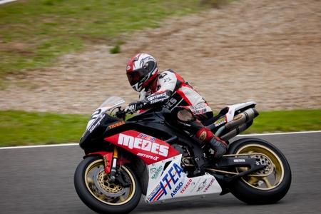 moto gp: JEREZ DE LA FRONTERA, SPAIN - NOV 20: Stock Extreme motorcyclist Manuel Tirado races in the CEV championship on Nov 20, 2010, in Jerez de la Frontera, Spain Editorial