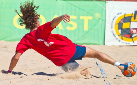CADIZ, SPAIN -  JUL 30:  Unknown player of the team of Gijon playing the Spanish Championship of Beach Soccer on Jul 30, 2005 on the beach of La Victoria in Cadiz, Spain Stock Photo - 10781275