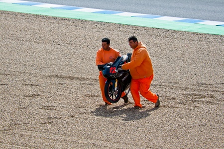 moto gp: JEREZ DE LA FRONTERA, SPAIN-MAR 5: 125cc motorcycle of Daniel Kartheininge after an accident on the official training of the world championship of MotoGP on March 5,2011 in Jerez de la Frontera, Spain