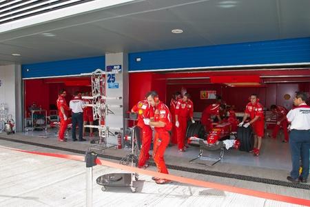 prix: JEREZ DE LA FRONTERA, SPAIN - OCT 10: Engineers of Scuderia Ferrari working in the car on pits on training session on October 10, 2006 in Jerez de la Frontera , Spain