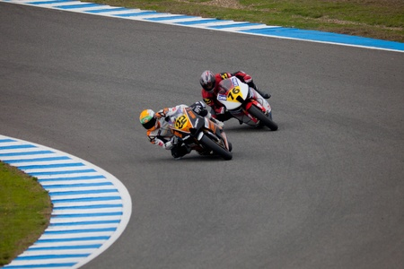 silva: JEREZ DE LA FRONTERA, SPAIN - NOV 20: MOTO2 motorcyclist Ivan Silva and Luis Miguel Mora takes a curve in the CEV championship on Nov 20, 2010, in Jerez de la Frontera, Spain