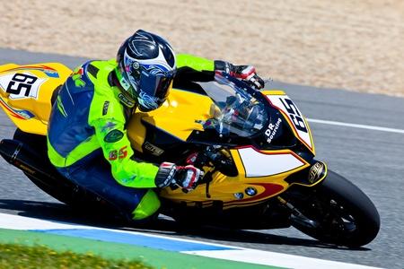 cev: JEREZ DE LA FRONTERA, SPAIN - APR 17: Stock Extreme motorcyclist Juan Eric Gomez takes a curve in the CEV Championship race on April 17, 2011 in Jerez de la Frontera, Spain