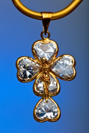 Pendant of a crucifix with five zirconia enchased photo