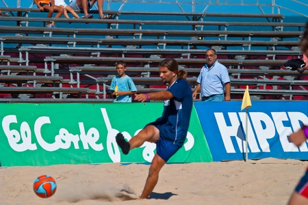 CADIZ, SPAIN -  JUL 30:  Unknown player of the team of Cadiz playing the Spanish Championship of Beach Soccer on Jul 30, 2005 on the beach of La Victoria in Cadiz, Spain