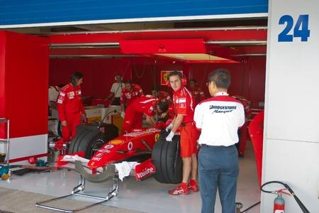 JEREZ DE LA FRONTERA, SPAIN - OCT 10: Engineers of Scuderia Ferrari working in the car on pits on training session on October 10, 2006 in Jerez de la Frontera , Spain