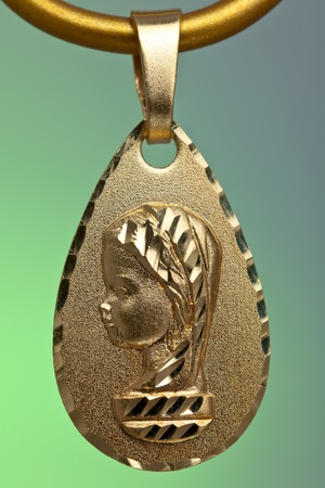 Precious gold pendant of the virgin girl, ideal to give  as a present for the young persons in the first communion photo