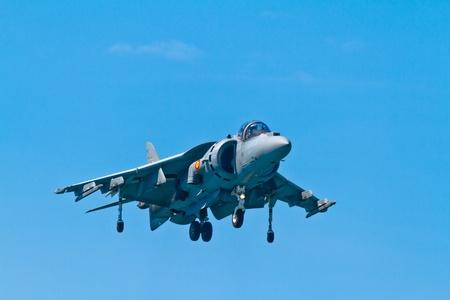 are thrust: CADIZ, SPAIN-SEP 11: Aircraft AV-8B Harrier Plus taking part in an exhibition on the 4th airshow of Cadiz on Sep 11, 2011, in Cadiz, Spain