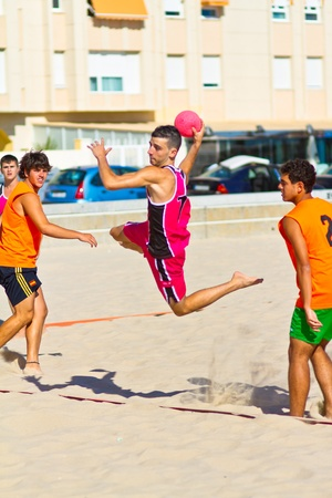 CADIZ, SPAIN - JULY 19: Unidentified players compete in a match between Autoescuela Barquin and CadizSur Seguros BMPY in the 19th league of beach handball of Cadiz on July 19, 2011 in Cadiz, Spain Stock Photo - 11128672