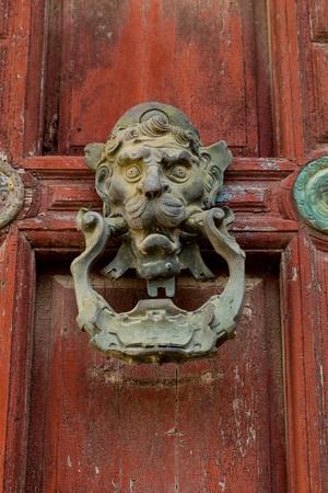 Detail Of An Ornate Door Knocker On The Door Of A Building Photo