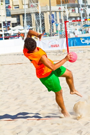 CADIZ, SPAIN - JULY 19: Unidentified players compete in a match between Autoescuela Barquin and CadizSur Seguros BMPY in the 19th league of beach handball of Cadiz on July 19, 2011 in Cadiz, Spain