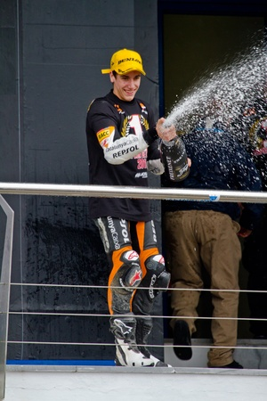 rins: JEREZ DE LA FRONTERA, SPAIN-NOV 20: 125cc motorcyclist Alex Rins on the podium like winner of the 125cc CEV Championship celebrating with champagne on November 20, 2011, in Jerez de la Frontera, Spain