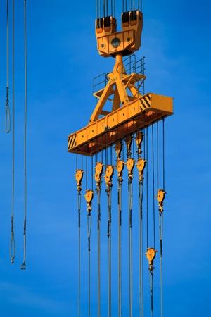 Cranes of the dockyards of Cádiz in a sunny day photo