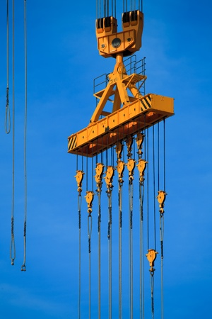 Cranes of the dockyards of C�diz in a sunny day photo