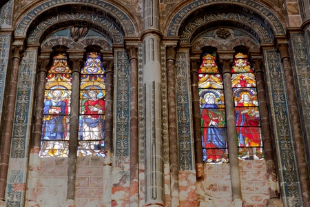 Wonderful ancient stained glass window formed of multiple colors