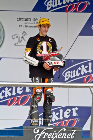 rins: JEREZ DE LA FRONTERA, SPAIN - NOV 20: 125cc motorcyclist Alex Rins on the podium like winner of the 125cc CEV Championship on November 20, 2011, in Jerez de la Frontera, Spain