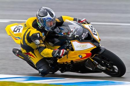 gomez: JEREZ DE LA FRONTERA, SPAIN - NOV 20: Stock Extreme motorcyclist Juan Eric Gomez takes a curve in the CEV Championship race on November 20, 2011 in Jerez de la Frontera, Spain