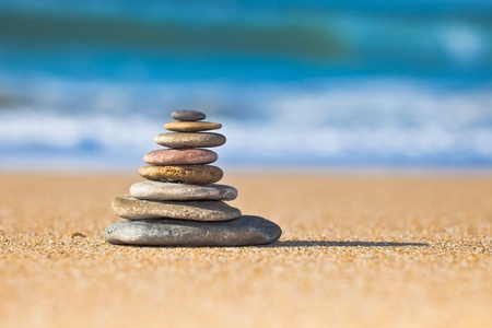massage symbol: Zen Stones on the beach Stock Photo