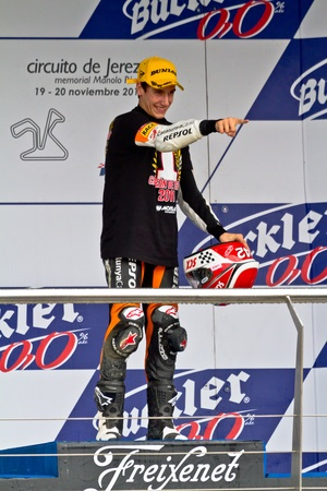 JEREZ DE LA FRONTERA, SPAIN - NOV 20: 125cc motorcyclist Alex Rins on the podium like winner of the 125cc CEV Championship on November 20, 2011, in Jerez de la Frontera, Spain Stock Photo - 11906832