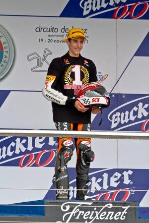 JEREZ DE LA FRONTERA, SPAIN - NOV 20: 125cc motorcyclist Alex Rins on the podium like winner of the 125cc CEV Championship on November 20, 2011, in Jerez de la Frontera, Spain