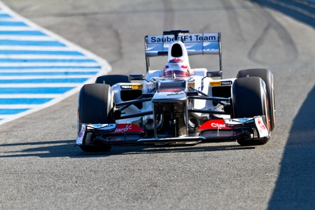 sauber: JEREZ DE LA FRONTERA, SPAIN - FEB 07: Kamui Kobayashi of Sauber F1 races on training session on February 07 , 2012, in Jerez de la Frontera , Spain Editorial