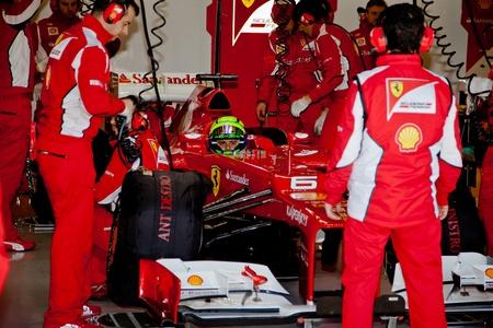 scuderia: JEREZ DE LA FRONTERA, SPAIN - FEB 07: Felipe Massa of Scuderia Ferrari F1 waiting in pit on training session on February 07 , 2012, in Jerez de la Frontera , Spain Editorial