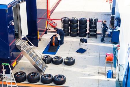 pirelli: JEREZ DE LA FRONTERA, SPAIN - FEB 06: Mechanics of the team Toro Rosso preparing pneumatic tires Pirelli  for the start of the trainings on February 06 , 2012, in Jerez de la Frontera , Spain