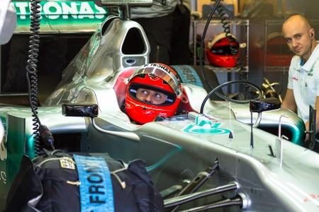 JEREZ DE LA FRONTERA, SPAIN - FEB 08: Michael Schumacher of Mercedes F1 waiting on pit on training session on February 08 , 2012, in Jerez de la Frontera , Spain Editorial
